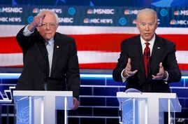 Democratic presidential candidates, Sen. Bernie Sanders, I-Vt., left, and former Vice President Joe Biden gesture during a Democratic presidential primary debate Feb. 19, 2020, in Las Vegas, hosted by NBC News and MSNBC.