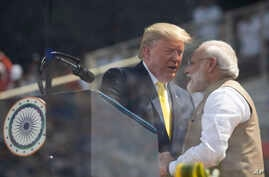"President Donald Trump and Indian Prime Minister Narendra Modi shake hands during a ""Namaste Trump,"" event at Sardar Patel Gujarat Stadium, Feb. 24, 2020, in Ahmedabad, India."