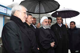In this photo released by the official website of the office of the Iranian Presidency, President Hassan Rouhani, center,…