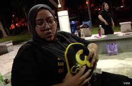 Sarah Baharudin, age 35, like many Malaysians has been leading an inactive lifestyle and eating unhealthy food for most of her life. Approximately half of the country's adults and about 30-percent of the youth are overweight or obese. (David Grunebaum/VOA)