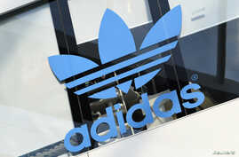 FILE - The Adidas logo is pictured during celebrations for German sports apparel maker Adidas' 70th anniversary at the company's headquarters in Herzogenaurach, Germany, August 9, 2019.
