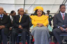 Newly-appointed Lesotho prime Minister Thomas Thabane (L), his wife Maesaiah Thabane and Zambian President Edgar Lungu (R) attend Thabane's inauguration on June 16, 2017 in Maseru.
