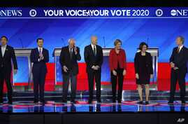 From left, Democratic presidential candidates Andrew Yang, Pete Buttigieg, Bernie Sanders, Joe Biden, Elizabeth Warren, Amy Klobuchar and Tom Steyer are seen ahead of their debate at Saint Anselm College in Manchester, New Hampshire, Feb. 7, 2020.
