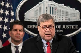U.S. Attorney General William Barr, right, with FBI Deputy Director David Bowdich standing behind him, speaks during a news conference at the U.S. Department of Justice, in Washington, Feb. 10, 2020.