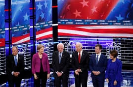 FILE - From left, Democratic presidential candidates Michael Bloomberg, Elizabeth Warren, Bernie Sanders, Joe Biden, Pete Buttigieg, Amy Klobuchar, stand on stage before a primary debate in Las Vegas, Nevada, Feb. 19, 2020.