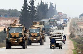 A Turkish military convoy is seen moving through eastern Idlib province, Syria, Feb. 28, 2020, a day after 33 Turkish soldiers were killed in the province in an airstike by Syrian government forces.
