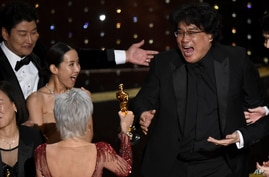 "Bong Joon Ho, right, reacts as he is presented with the award for best picture for ""Parasite"" from presenter Jane Fonda at the Oscars, Feb. 9, 2020, at the Dolby Theatre in Los Angeles, California."