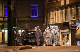 Police forensic officers work on the scene after a stabbing incident in Streatham neighborhood of London, England, Feb. 2, 2020.