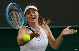 Russia's Maria Sharapova returns to Pauline Parmentier of France in a Women's singles match during day two of the Wimbledon Tennis Championships in London, July 2, 2019.