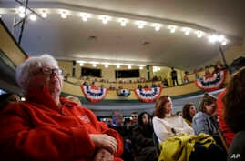 People listen during a rally for Democratic presidential candidate Bernie Sanders, not shown, in Derry, New Hampshire, Feb. 5, 2020.