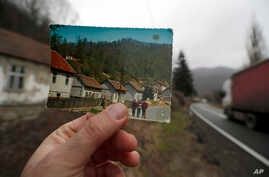 In this photo taken on Jan. 23, 2020, an old postcard shows how the village of Blagojev Kamen, Serbia, looked like fifty years ago.