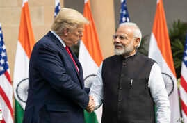 President Donald Trump and Indian Prime Minister Narendra Modi shake hands before their meeting at Hyderabad House, in New Delhi, India, Feb. 25, 2020.