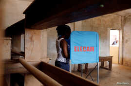 FILE - A woman casts her vote at a polling station during elections, in Yaounde, Cameroon, Oct. 7, 2018.