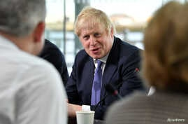 FILE - Britain's Prime Minister Boris Johnson chairs a cabinet meeting at the National Glass Center at the University of Sunderland, in Sunderland, Britain, Jan. 31, 2020.