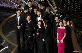 "Kwak Sin Ae and Bong Joon-ho win the Oscar for Best Picture for ""Parasite"" at the 92nd Academy Awards in Los Angeles, Calif., Feb. 9, 2020."