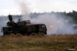 """FILE - A Russian Pantsir-S1 missile and artillery weapon system fires during a demonstration at the international military-technical forum """"ARMY-2016"""" in Moscow region, Russia, Sept. 6, 2016."""