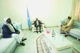 FILE - Somalia's Prime Minister Hassan Ali Kheyre meets with ASWJ leaders in Dhusamareeb, Sept. 3, 2019, in a photo released by the Prime Minister's Office.