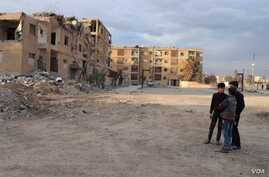 When Islamic State militants were defeated, they left half-destroyed buildings now housing displaced families from Idlib, in Raqqa, Syria, Feb. 23, 2020. (Heather Murdock/VOA)