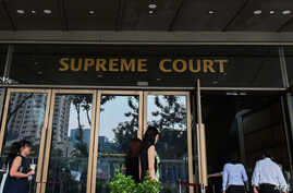 People enter the Supreme Court building in Singapore on November 13, 2019. - A Singaporean court on November 13 began hearing…