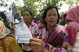 Farmers from some of provinces stage a protest rally near prime minister's residence in Phnom Penh, Cambodia, Monday, July 22,…