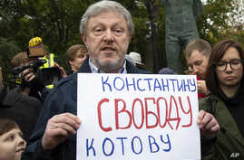 "Russian politician Grigory Yavlinsky holds a poster reading: ""Freedom to Konstantin Kotov"", an opposition activist in jail, during a protest in the center of Moscow, Russia, Aug. 17, 2019."