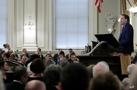 Republican N.H. Gov. Chris Sununu addresses legislators during his State of the State address at the State House in Concord, N.H., Feb. 13, 2020.