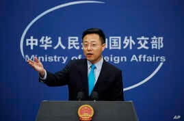 Chinese Foreign Ministry new spokesman Zhao Lijian gestures as he speaks during a daily briefing at the Ministry of Foreign Affairs office in Beijing, Feb. 24, 2020.