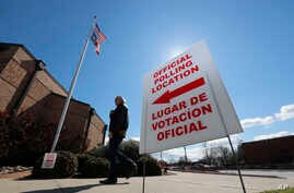 Using both the English and Spanish language, a sign points potential voters to an official polling location during early voting…