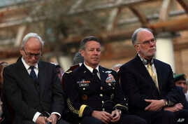 Gen. Scott Miller, center, chief of the U.S.-led coalition in Afghanistan, attend during a joint news conference in…