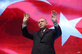 Turkey's President Recep Tayyip Erdogan gestures as he addresses his ruling party members, in Ankara, Turkey, Monday, March 2,…