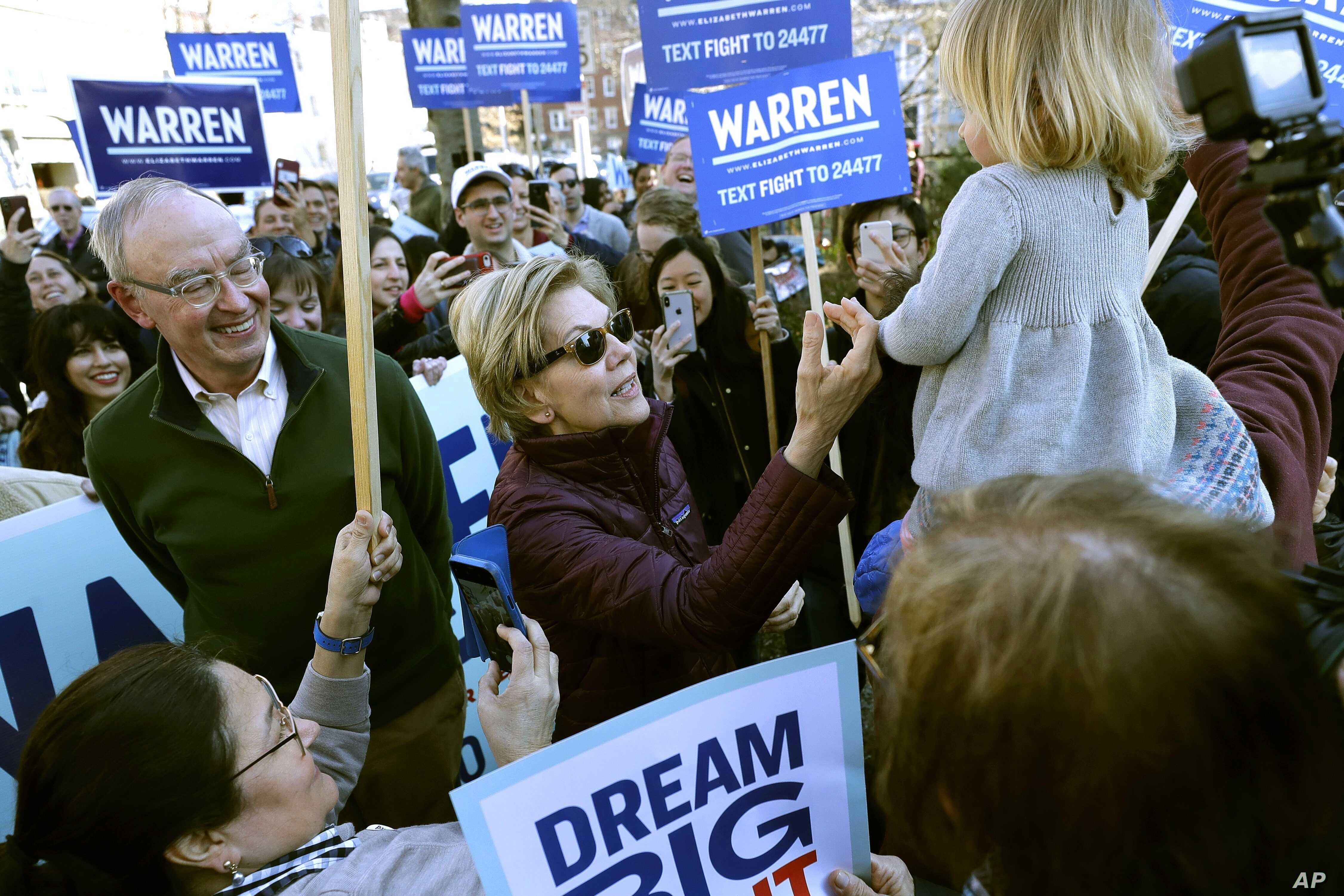 Democratic presidential candidate Sen. Elizabeth Warren, D-Mass., greets a young supporter