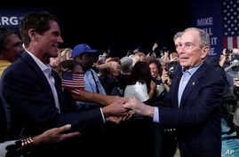 Democratic presidential candidate, former New York City Mayor Mike Bloomberg shakes hands during a campaign rally