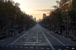 An avenue is seen empty in Barcelona, Spain, Sunday, March 15, 2020.