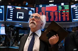 Trader Peter Tuchman works on the floor of the New York Stock Exchange Monday, March 16, 2020.