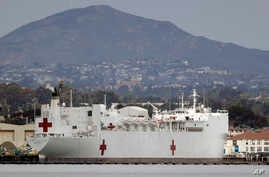 The USNS Mercy, a Navy hospital ship is seen docked at Naval Base San Diego Wednesday, March 18, 2020, in San Diego. Defense…