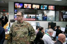 Major General Michael T. McGuire, the Director of the State of Arizona Department of Emergency and Military Affairs (DEMA) is looking as members of DEMA work responding to the coronavirus pandemic, Phoenix, March 18, 2020.