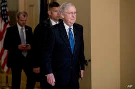 Senate Majority Leader Mitch McConnell of Ky. walks to the Senate Chamber on Capitol Hill in Washington, March 23, 2020.
