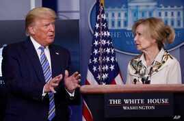 President Donald Trump asks a question to Dr. Deborah Birx, White House coronavirus response coordinator, during a briefing.