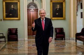 Senate Majority Leader Mitch McConnell of Ky. gives a thumbs up as he arrives on Capitol Hill, March 25, 2020.