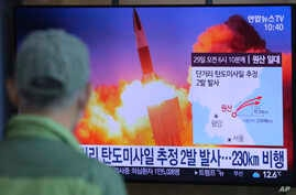 A man watches a TV screen showing a file image of North Korea's missile launch during a news program at the Seoul Railway Station in Seoul, South Korea, Sunday, March 29, 2020.