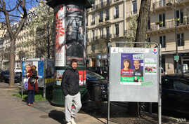 Campaign posters in Paris, March 15, 2020. (L. Bryant/VOA)