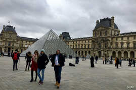 Tourists visit the Louvre Museum in Paris, which reopened March 4, 2020, after being temporarily shut over staff coronavirus concerns. (Lisa Bryant/VOA)