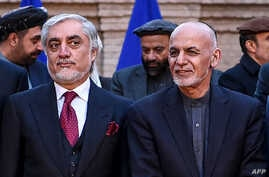 FILE - Afghan presidential election opposition candidate Abdullah Abdullah (L) and Afghanistan's President Ashraf Ghani are seen after a press conference at the presidential palace in Kabul, Feb. 29, 2020.