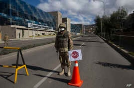 A soldier blocks an empty street during a government-ordered lockdown, in La Paz, Bolivia, March 23, 2020.