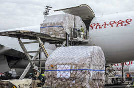 A cargo flight containing over six million medical items including face masks, test kits, face shields and protective suits arrives in the capital Addis Ababa, Ethiopia, March 22, 2020.