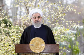 In this photo released by the official website of the office of the Iranian Presidency, President Hassan Rouhani delivers a message for the Iranian New Year, or Nowruz, in Tehran, March 20, 2020.