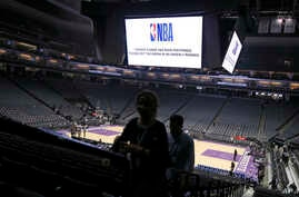 FILE - Fans leave the Golden 1 Center after the NBA basketball game between the New Orleans Pelicans and Sacramento Kings was canceled at the last minute amid coronavirus fears, in Sacramento, California, March 11, 2020.