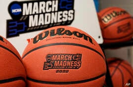 Official March Madness 2020 tournament basketballs are seen in a store room at the CHI Health Center Arena, in Omaha, Nebraska, March 16, 2020.