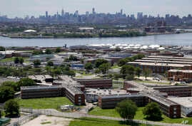 FILE - This June 20, 2014 photo shows the Rikers Island jail complex in New York with the Manhattan skyline in the background.