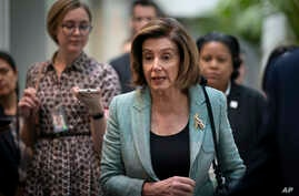 FILE - Speaker of the House Nancy Pelosi speaks to reporters as she arrives for a meeting with fellow Democrats, on Capitol Hill, in Washington, March 10, 2020.
